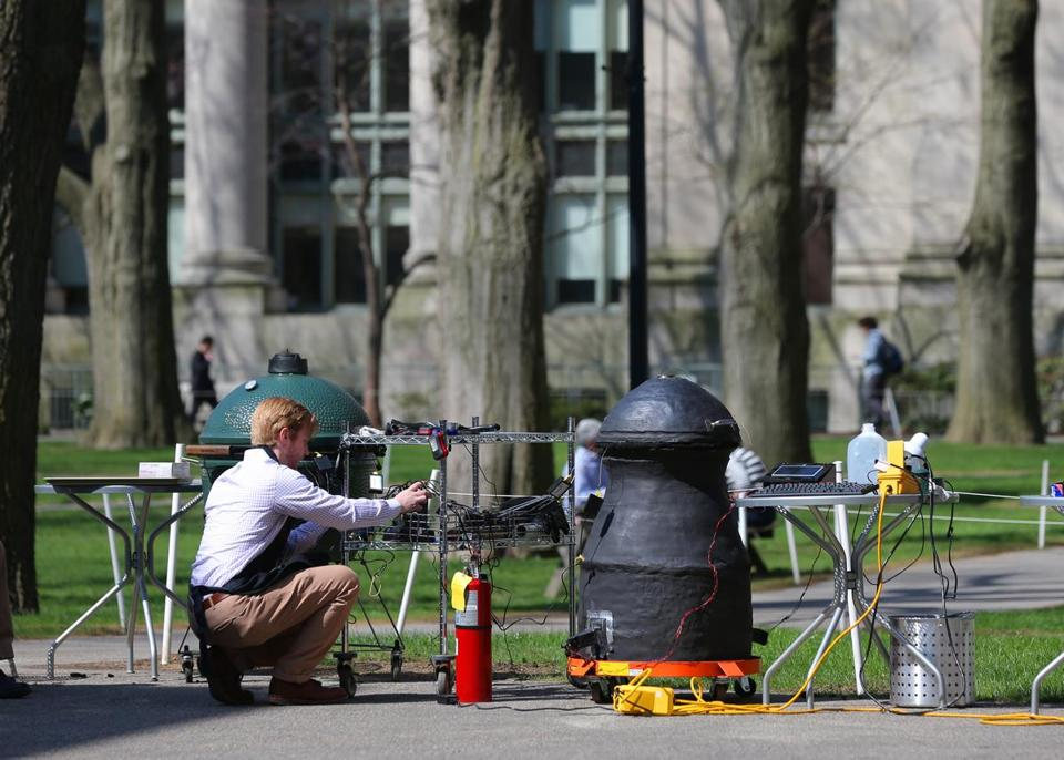 The smoker is made of ceramic and is hourglass-shaped. Peyton Nesmith monitored the proceedings in Harvard Yard.