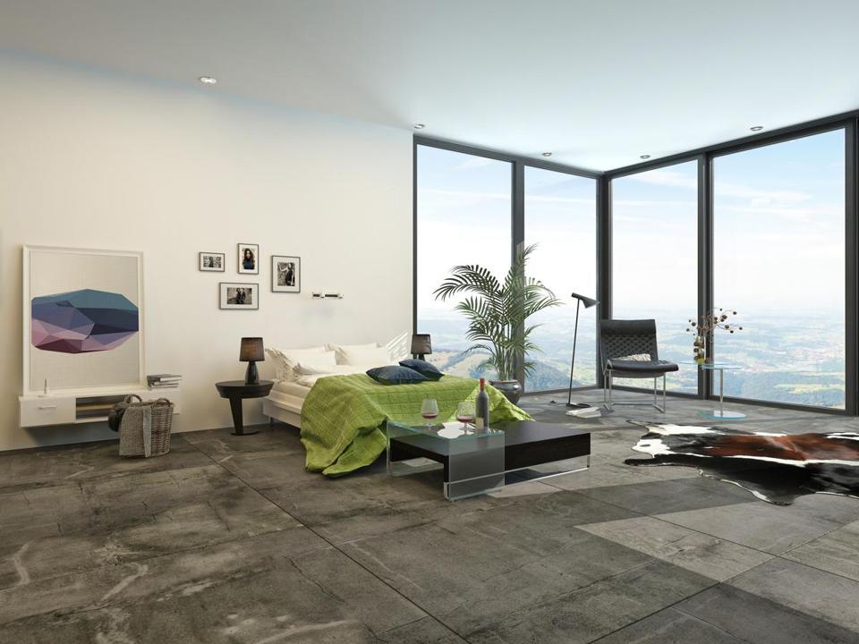 A Bedroom With Corner Window