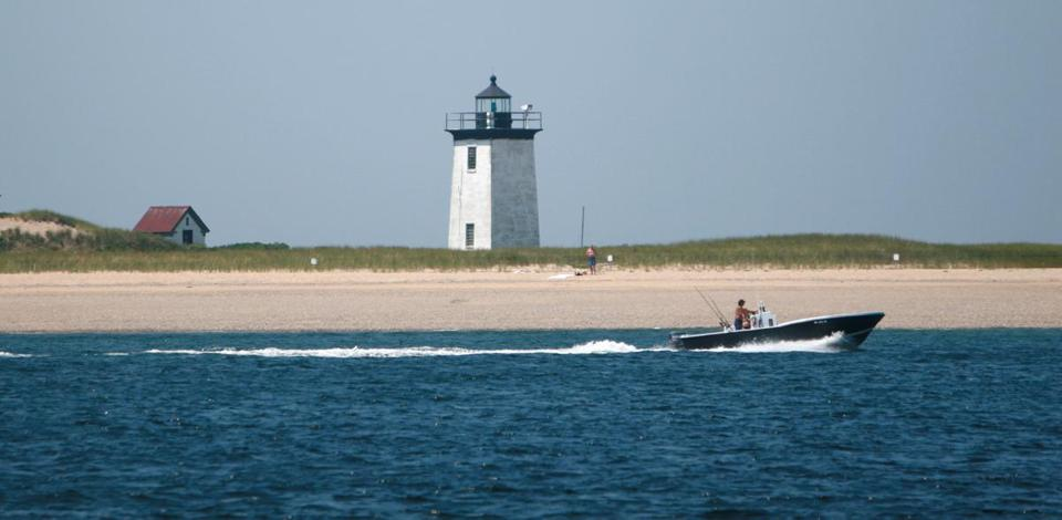 Lighthouse off of Long Point. Cape Cod and Provincetown.; Shutterstock ID 4299946; PO: long point