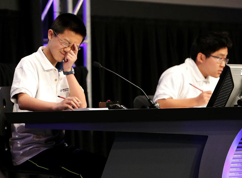 Kevin Liu of Carmel, Ind., pondered a question as he faced Frank Han (right) of Minnesota.