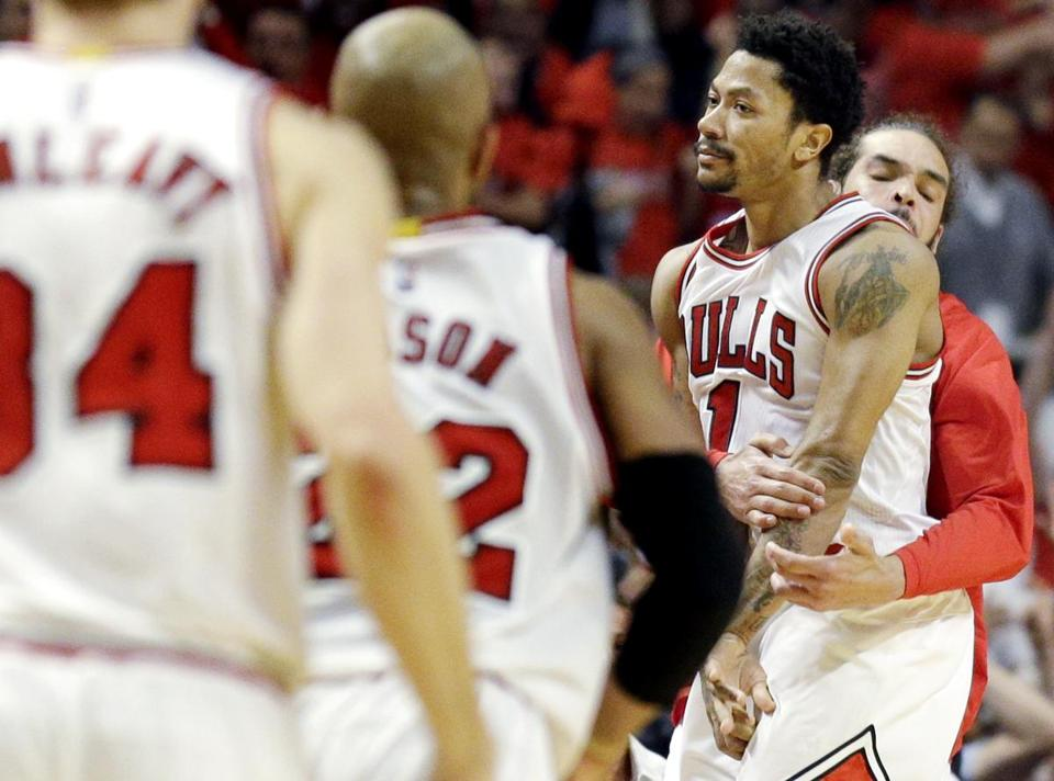 Bulls guard Derrick Rose (1) was mobbed by his teammates after hitting the  winning c09cb50df