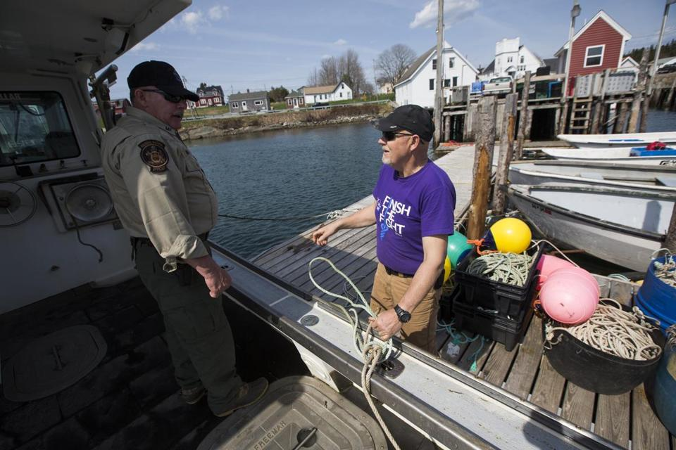 Maine Marine Patrol specialist Mark Murray with lobsterman Brian Cates of Maine.