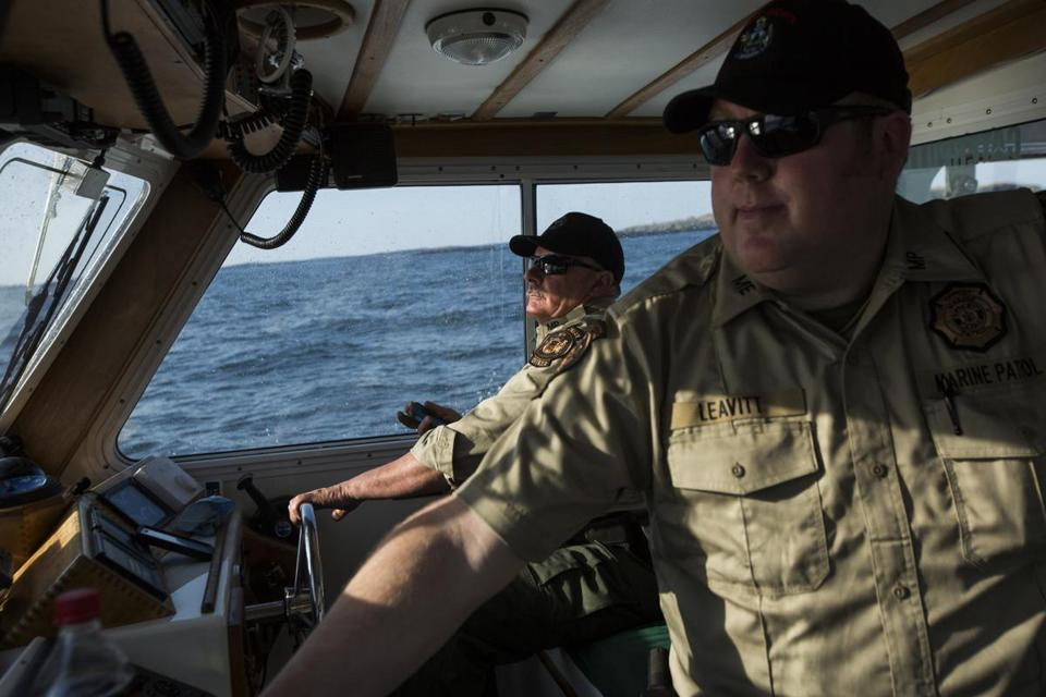 Maine Marine Patrol specialist Mark Murray, left, and officer Jason Leavitt patroled the waters near the Machias Seal Island on May 7.