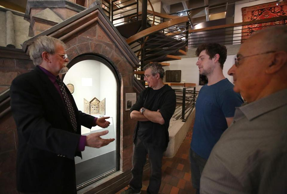 At the Armenian Library and Museum of America in Watertown, curator Gary Lind-Sinanian (left) and director Berj Chekijian (right) give Eric Bogosian and his son Travis (center) a tour.