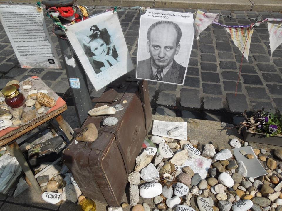 Poignant personal mementos have been placed at the foot of a Holocaust memorial statue in Budapest that depicts Hungary as the innocent victim of Nazi Germany.