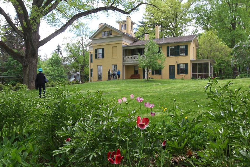 MAY 13, 2015 - AMHERST- MA- Daytripping - Amherst MA . Emily Dickinson birthplace, backyard looking towards hourse with tree at left that was a favorite of Emily's. (globe staff photo :Joanne Rathe reporter: section: magazine : topic: 060715daytripping)