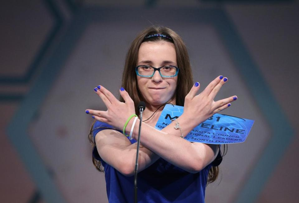 A contestant celebrated after spelling a word correctly at the 2014 Scripps National Spelling Bee competition in National Harbor, Md.