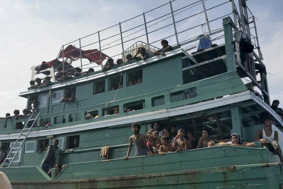 Hundreds of migrants were seen on a boat drifting about 10 miles off the coast of Thailand.