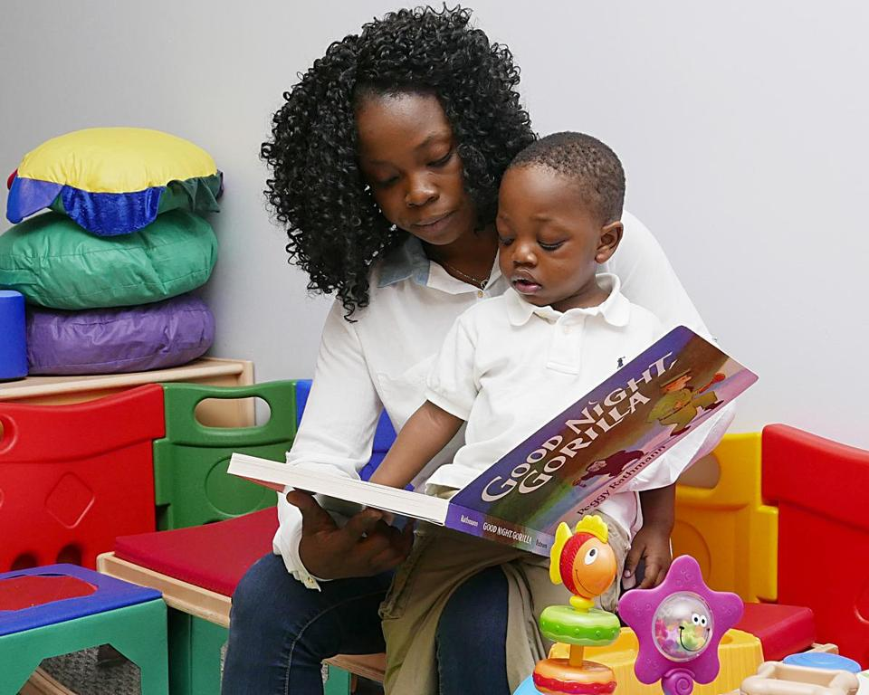 Rose Quoi, 19, of Brockton, reads to her 2-year-old son, Marquis.