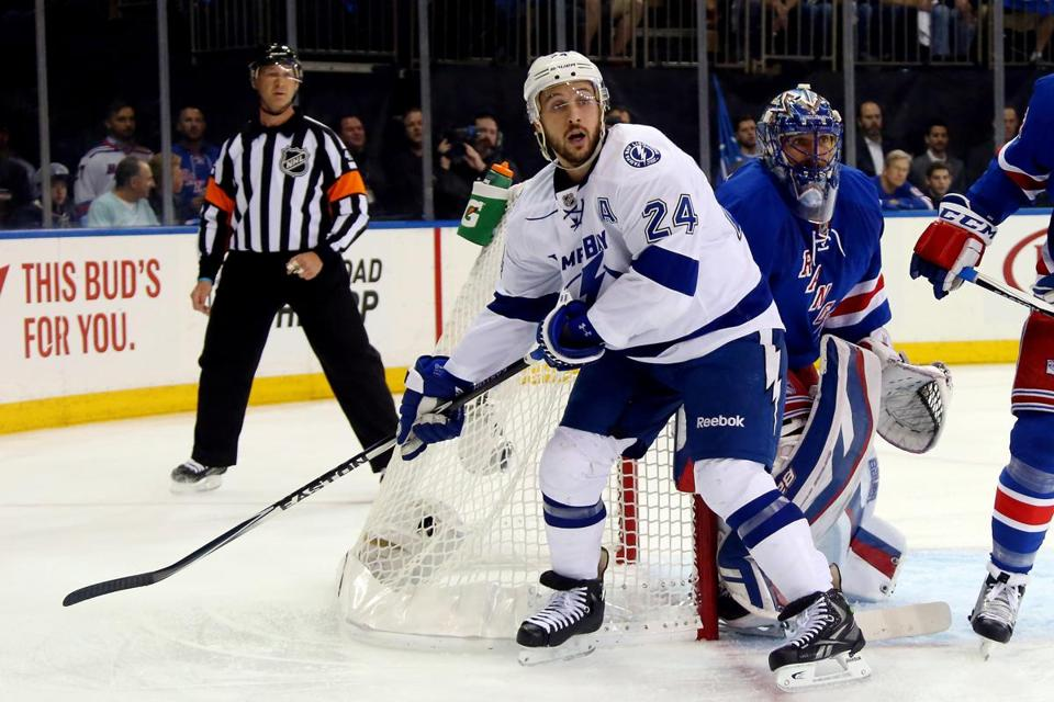Ryan Callahan looked for the puck in front of Henrik Lundqvist in Game 1 of the Eastern Conference finals.