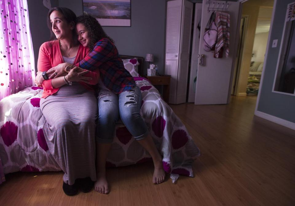 Zohra Khamis (above left) and her daughter Sarah, 13, at home in Revere. Khamis and Sarah (in a family photo, at right) participated in a study at Massachusetts General Hospital to help them make lifestyle changes to improve Sarah's nutrition and health.