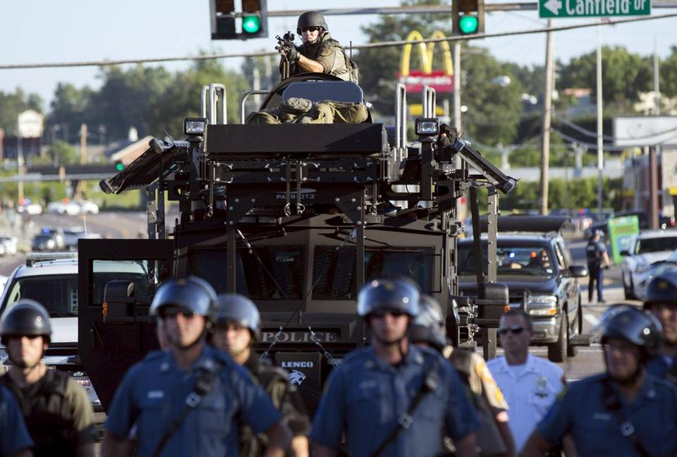 Riot police used a former military vehicle to quell protests after the shooting death of an unarmed teen in Ferguson, Mo.