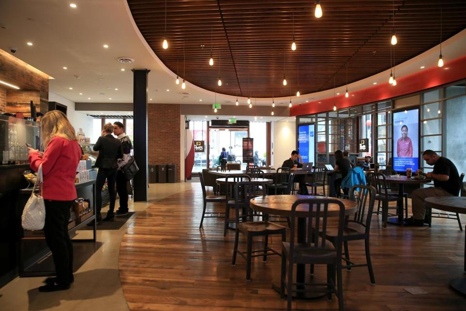 the capital one cafe combines a peets coffee shop with digital lifestyle coaches to