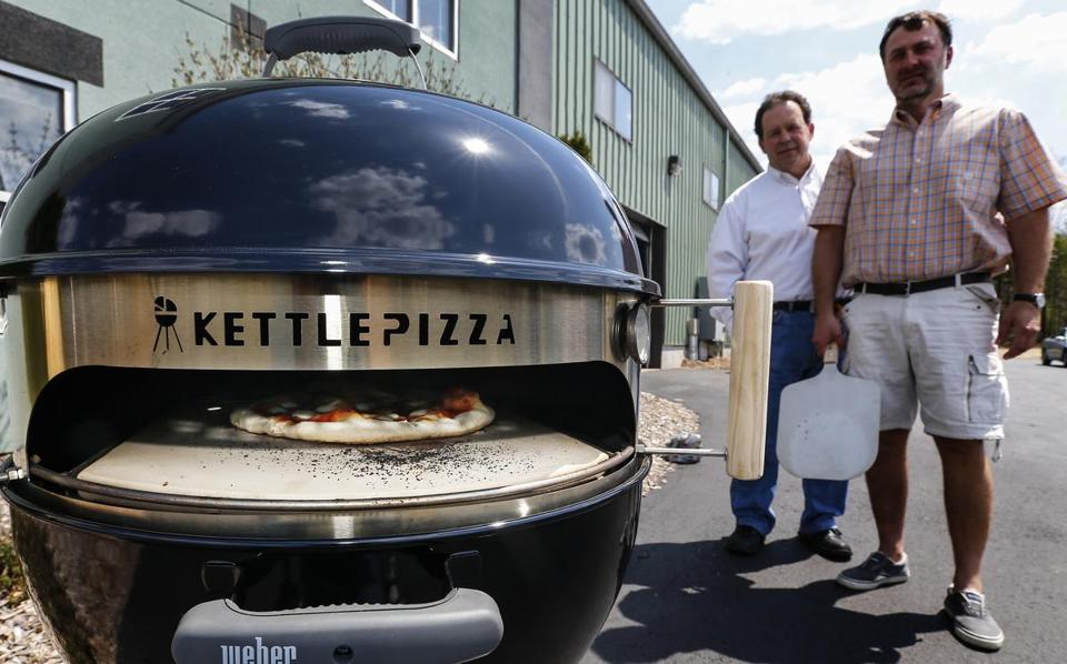 Groveland, MA, Monday, May 4, 2015: George Peters, left, and Al Contarino, right, two inventors who made KettlePizza a gadget that fits on Webber grills. CREDIT: Cheryl Senter for The Boston Globe