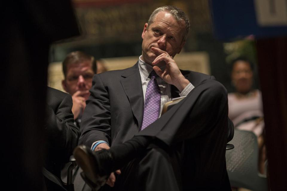 Massachusetts Governor Charlie Baker listens during an assembly of over 1800 faith leaders from the Greater Boston Interfaith Organization at Trinity Church in Boston, Mass., May 6, 2015. (Keith Bedford/Globe Staff)