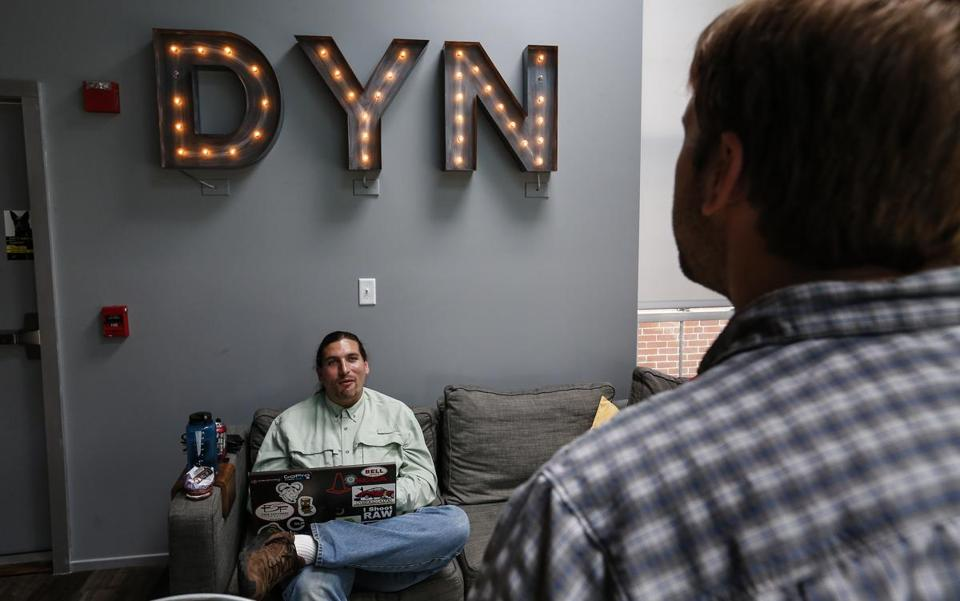 Manchester, NH, Tuesday, May 19, 2015: Meeting in the kitchen, Dynamic Network Services Inc CEO Jeremy Hitchcock, right, talks with security administrator Neil Schelly, left. DYN is a start up tech company situated in a renovated mill building. CREDIT: Cheryl Senter for The Boston Globe