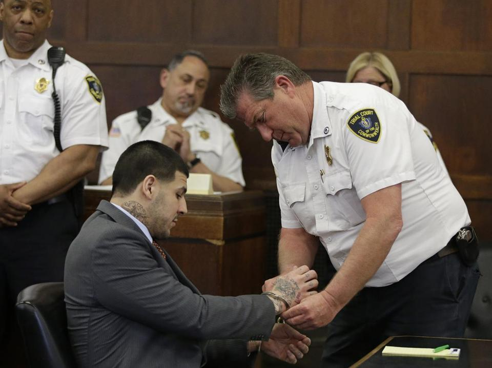 Aaron Hernandez hadhis handcuffs removed before his arraignment at Suffolk Superior Court on Thursday.