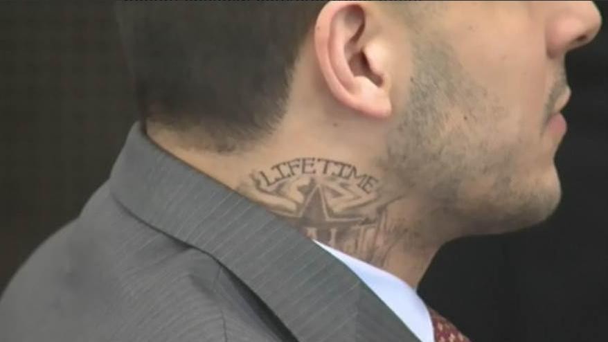 Aaron hernandez sports new tattoo at court appearance for Aaron hernandez neck tattoo meaning