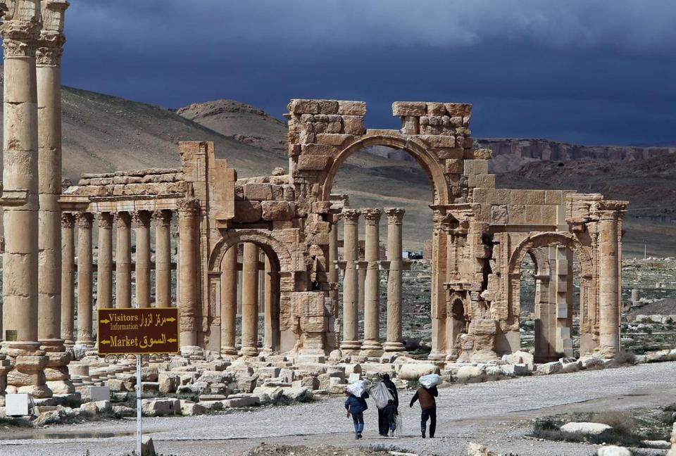 Syrian citizens walked in the ancient oasis city of Palmyra, northeast of Damascus. Activists fear that members of the Islamic State group will destroy the UNESCO heritage site.