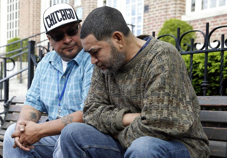 Outreach worker Ruben Rodriguez (left) teared up as he talks to a man in Bellingham Square about his struggles with alcohol.