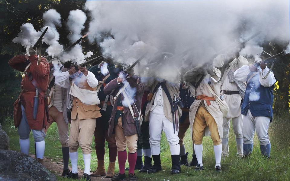 Reenactors from the 6th Middlesex Regiment fired their muskets at a 2014 benefit at the Old Manse in Concord.