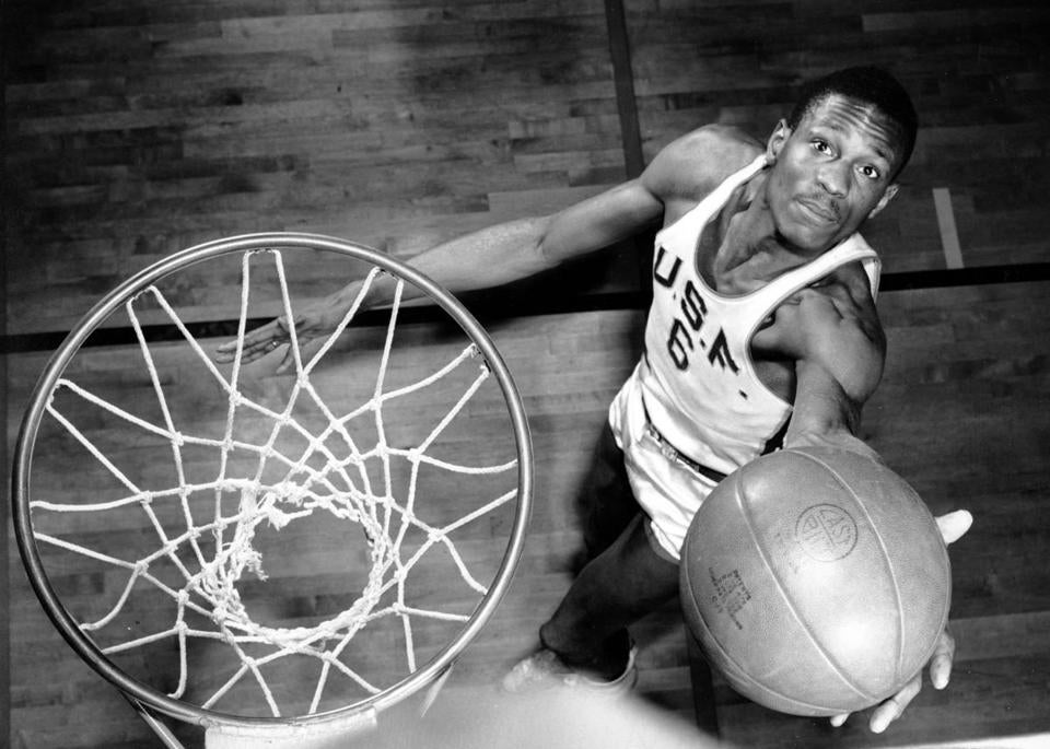 Bill Russell, member of the University of San Francisco basketball team, shows how he scores baskets on Feb. 23, 1956. The 6-foot, 10-inch center, ranked one of the best, has helped his team win 20 straight games during the current season. (AP Photo)
