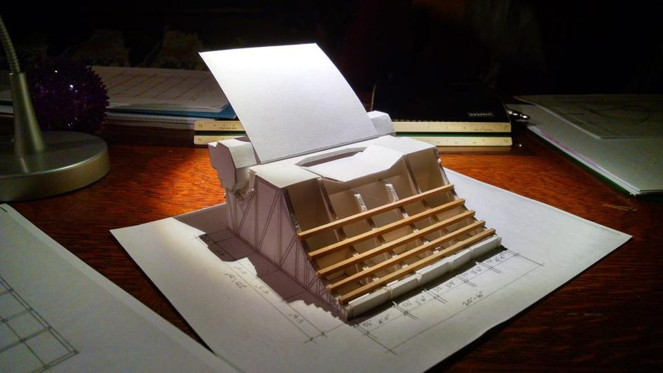 A paper model illustrated what the finished giant typewriter will look like.