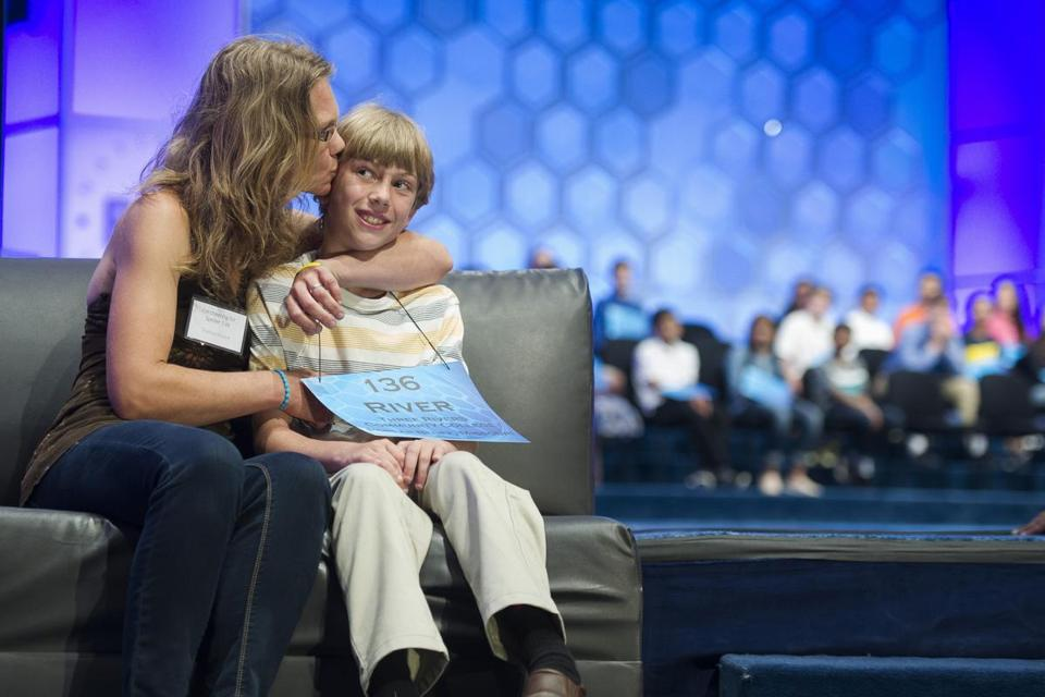 River Blount, 11, of Poplar Bluff, Mo., received a kiss from his mother, Shannon Blount, after misspelling a word.