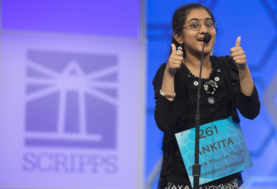 Ankita Vadiala of Manassas, Va., reacts after correctly spelling her word.