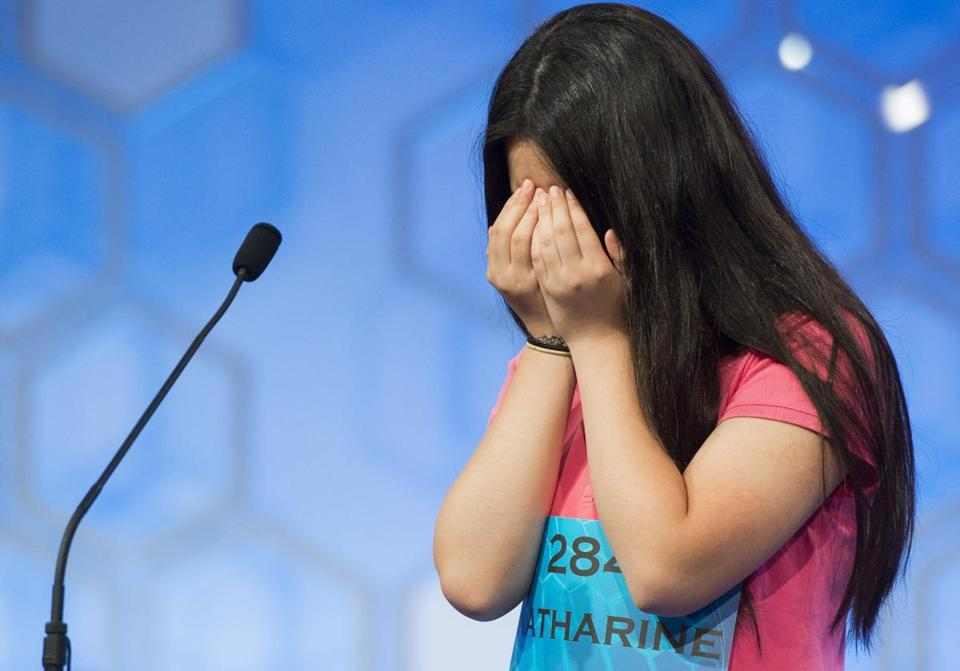 Katharine Wang of Morristown, N.J. reacts after hearing her word during the semifinal round.