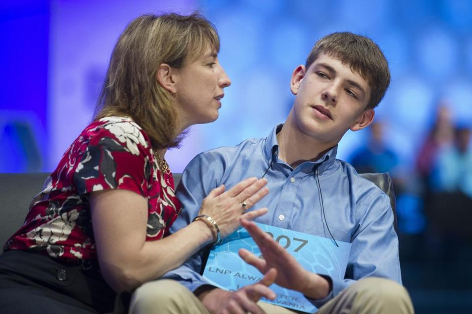 "William Yaeger, 13, of Lancaster, Pa., pulled away as he mother, Viki Yaeger, tries to kiss him after he misspelled the word ""corroboree."""
