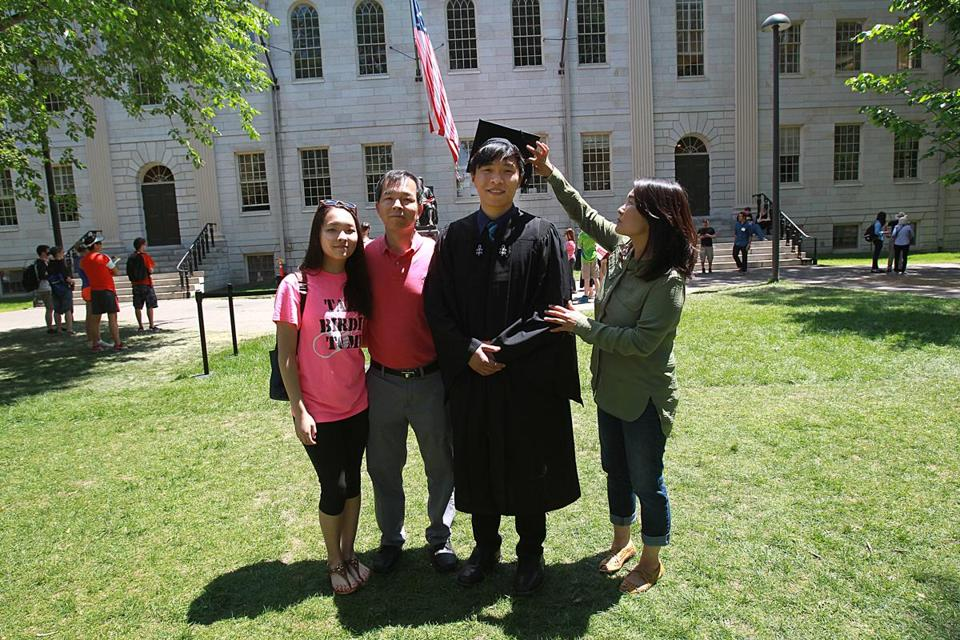 Joey Kim (center) graduated from Harvard in 2015.