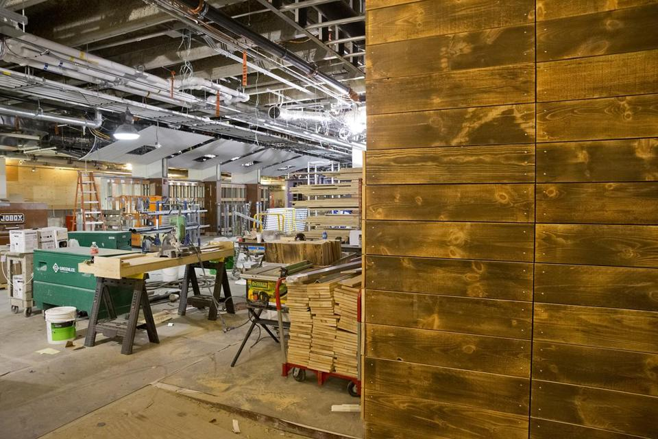Wood used to panel walls in the Boston Public Market was collected and recycled from New England barns.