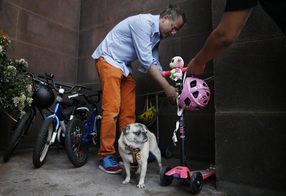Mezrich unties his dog, Bugsy, after walking his kids to school in Boston.