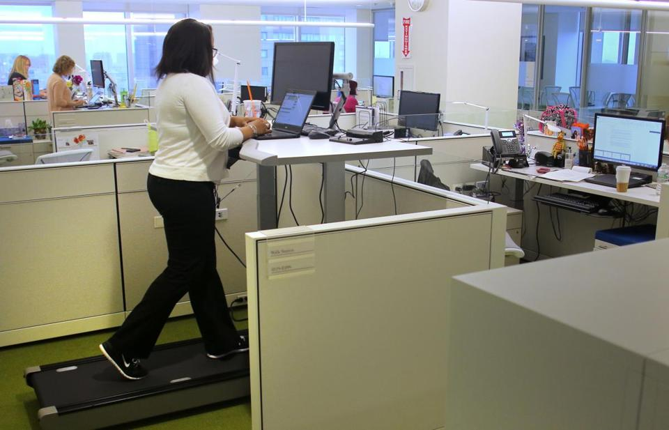 An employee uses a walking station while working at Blue Cross Blue Shield of Massachusetts.