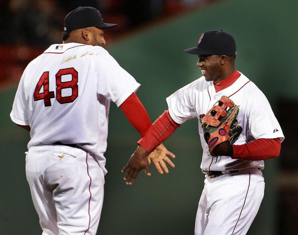 Outfielder Rusney Castillo (right), who drove in the game's lone run, got a hand from third baseman Pablo Sandoval after the final out.