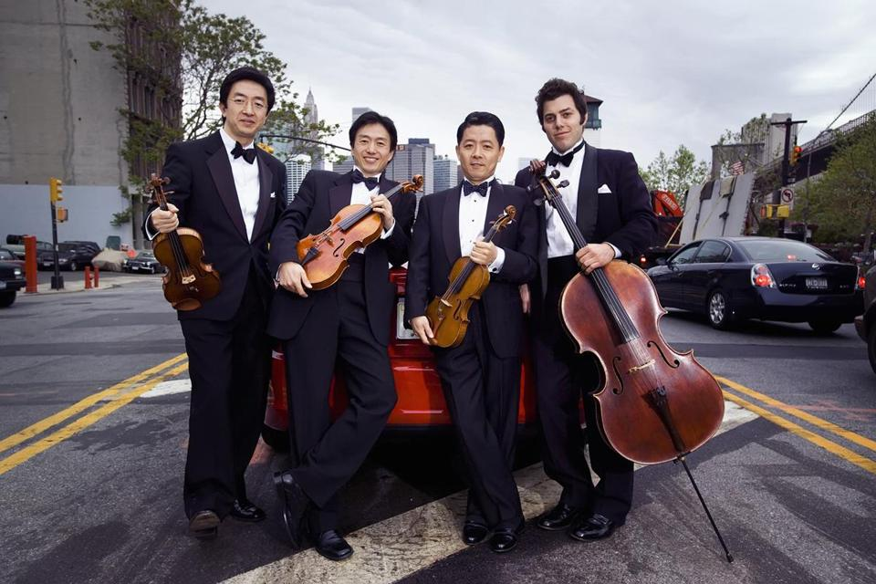 The Shanghai Quartet is (from left) violinist Weigang Li, violist Honggang Li, violinist Yi-Wen Jiang, and cellist Nicholas Tzavaras.