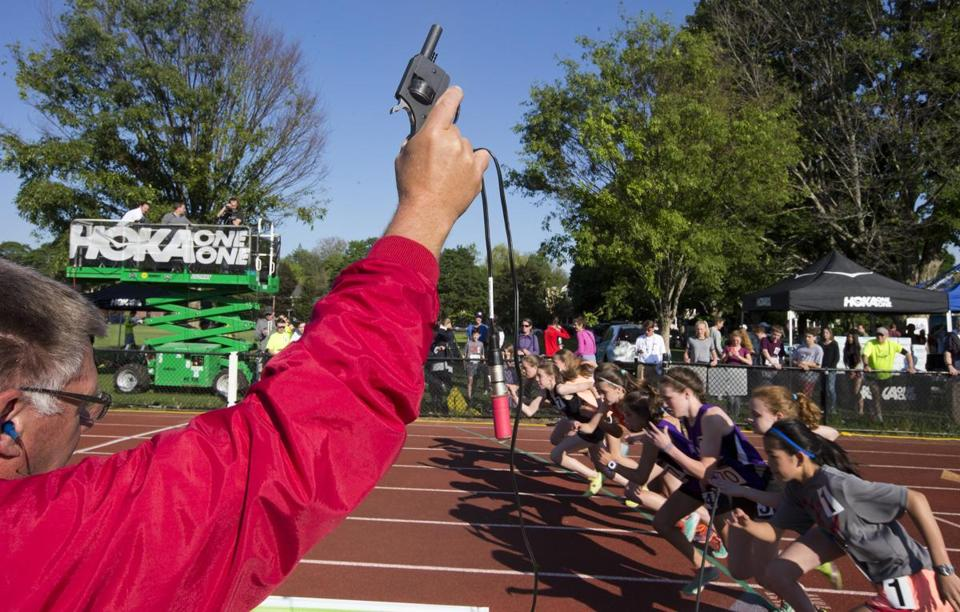 Concord, MA-June 5, 2015-Globe Staff Photo by Stan Grossfeld- Not exactly the shot heard round the world. Just the starter's pistol at the Adrian Martinez Classic held at the Emerson Playground.