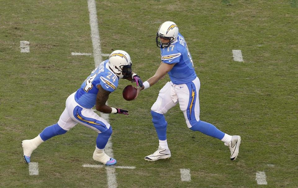 San Diego Chargers quarterback Philip Rivers, right, hands off to running back Ryan Mathews in the first half of an NFL football game against the Denver Broncos Monday, Oct. 15, 2012, in San Diego. (AP Photo/Gregory Bull)