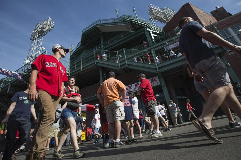 Fans head to Fenway to cheer the team at their own risk, signs and tickets say.