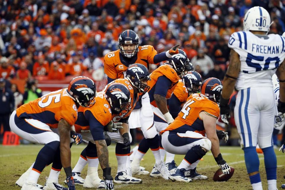 Denver Broncos quarterback Peyton Manning (18) calls a play to his line during the first half of an NFL divisional playoff football game against the Indianapolis Colts, Sunday, Jan. 11, 2015, in Denver. (AP Photo/Jack Dempsey)
