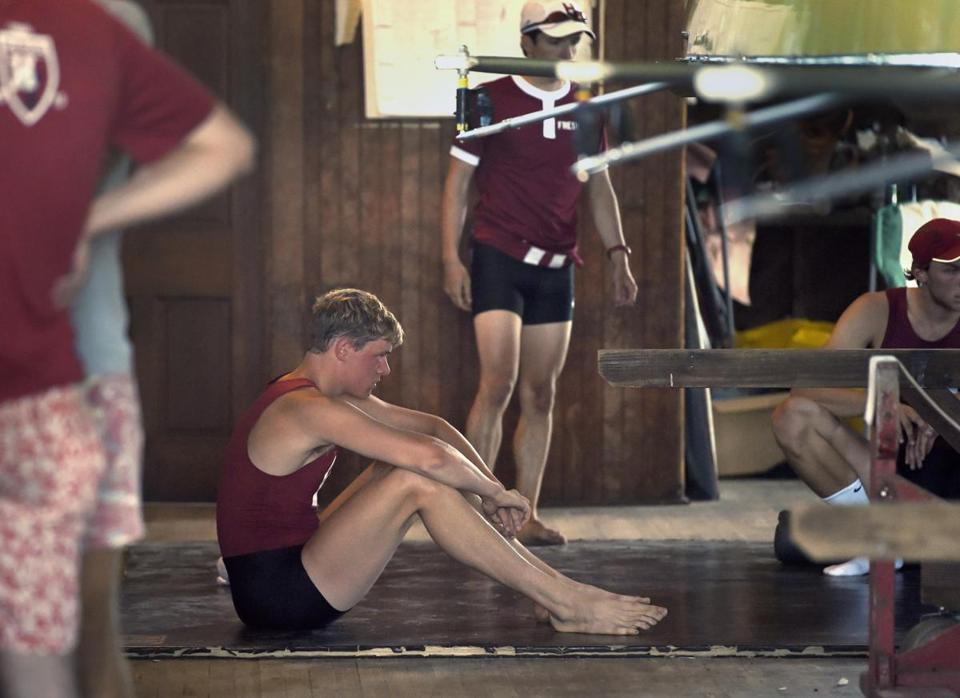 Harvard's six seat Charles Risbey sits on the boathouse floor reacting after their loss to Yale in the 150th Harvard-Yale Regatta on the Thames River in Gales Ferry, Conn., Sunday, June 7, 2015. (Tim Martin/The Day via AP) MANDATORY CREDIT