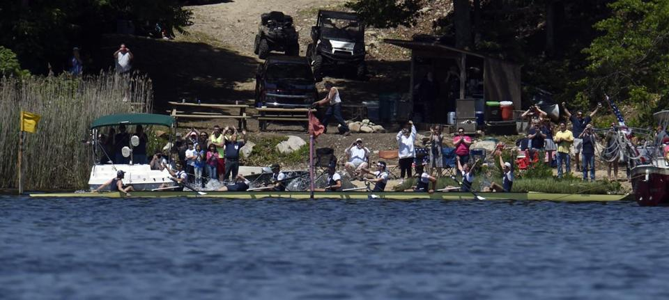 Yale celebrates its victory in the 150th Harvard-Yale Regatta on the Thames River in Gales Ferry, Conn.