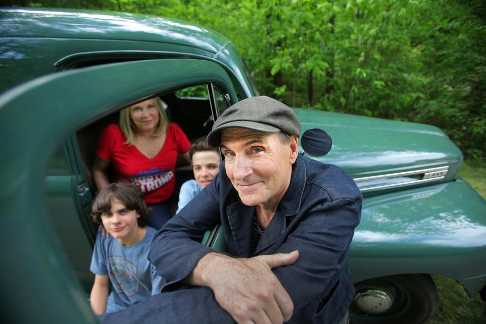 James Taylor, pictured with his wife, Kim, and twin sons Rufus (left) and Henry.
