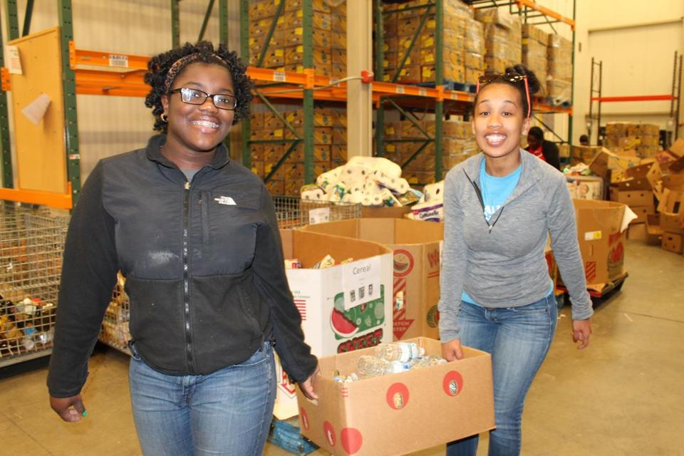 Luna Charles (left) of Brockton, with Crossroads for Kids staffer Elvira Teixeira, made a service trip to Washing-ton, D.C. in April.