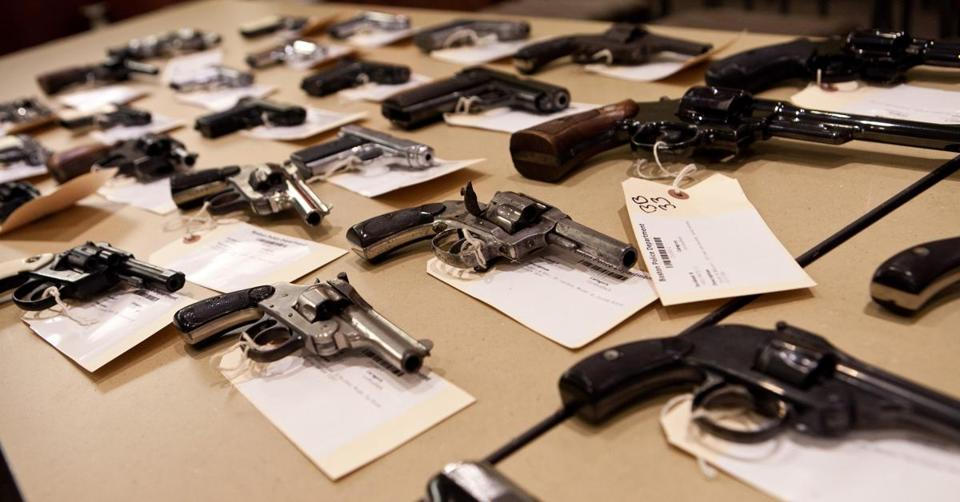 Guns from a previous citywide gun buyback program were seen at Boston police headquarters in 2014.