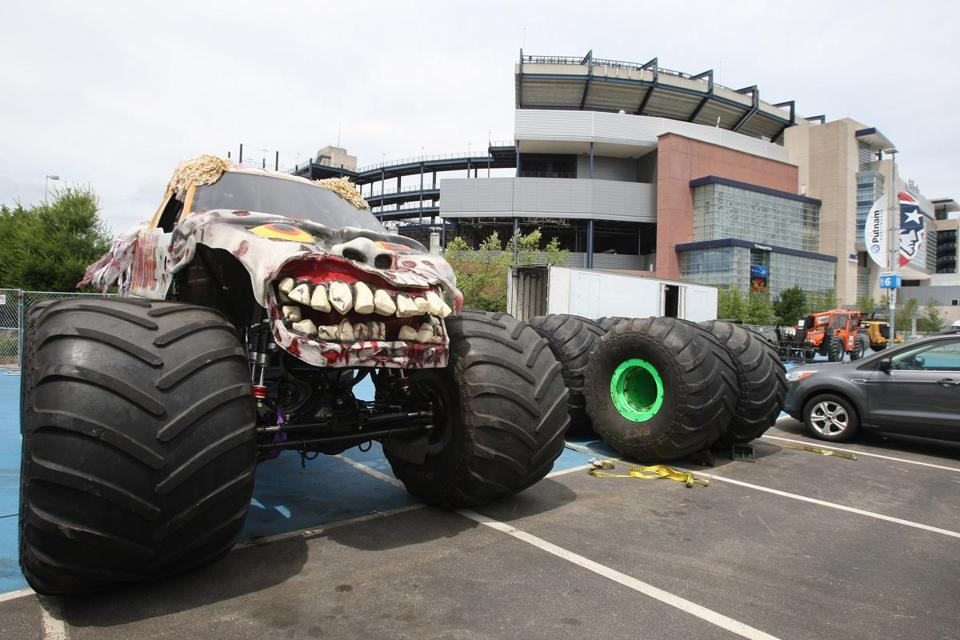 Foxboro,MA 06/17/15 photos of Gillette Stadium on day one of two day process of transforming the football/soccer field into a monster truck course for this weekend's event. most of today's work was consumed with spreading the base soil, tomorrow additional topsoil and moguls will be added. MONSTER TRUCK SITS OUTSIDE THE STADIUM ON PIT ROW... .(photo by George Rizer ) reporter, callum borchers