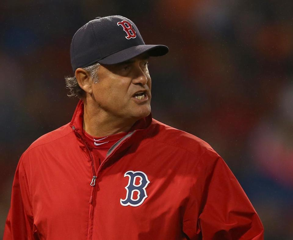 BOSTON, MA - JUNE 15: John Farrell #53 of the Boston Red Sox reacts after it was ruled that Andrelton Simmons #19 of the Atlanta Braves was hit by a pitch in the seventh inning at Fenway Park on June 15, 2015 in Boston, Massachusetts. (Photo by Jim Rogash/Getty Images)