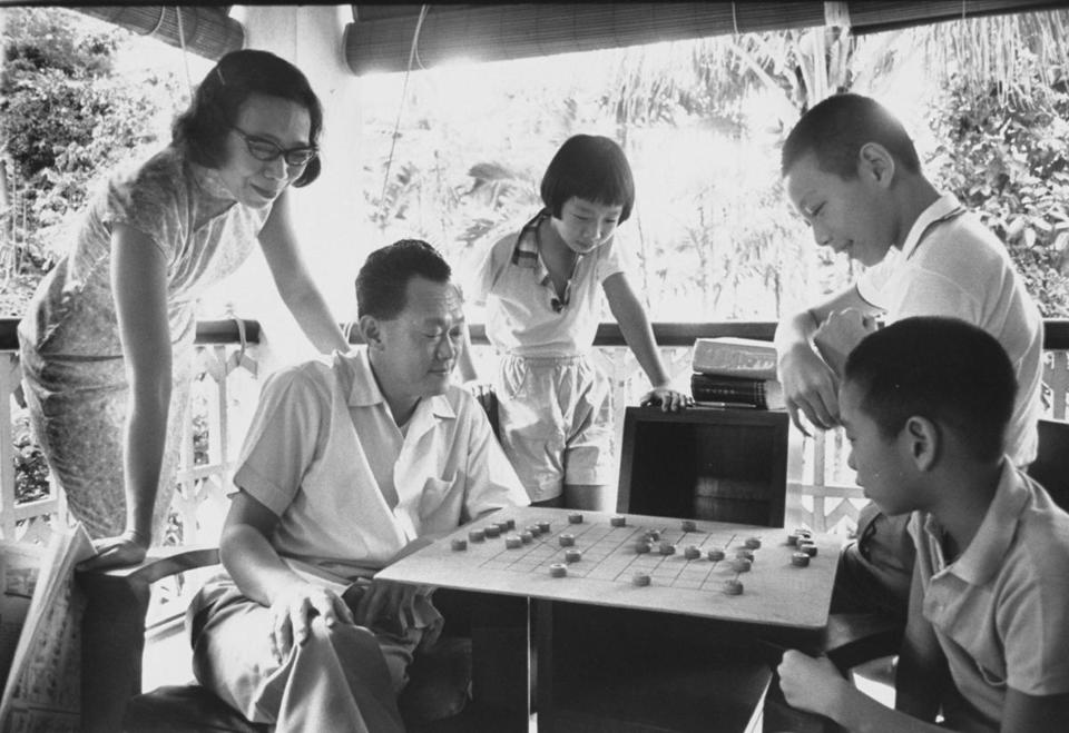 Lee Kuan Yew with his wife (left) and children at home in 1965, the year Singapore became independent.
