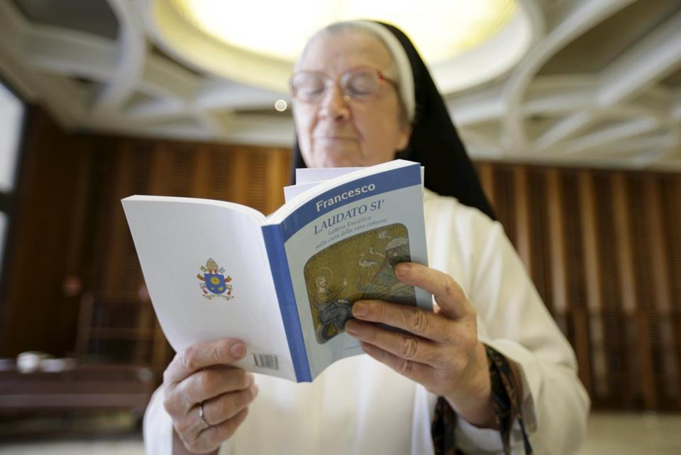 "A nun read Pope Francis' new encyclical titled ""Laudato si"" at the Vatican in 2015."
